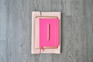 white and pink box on white textile