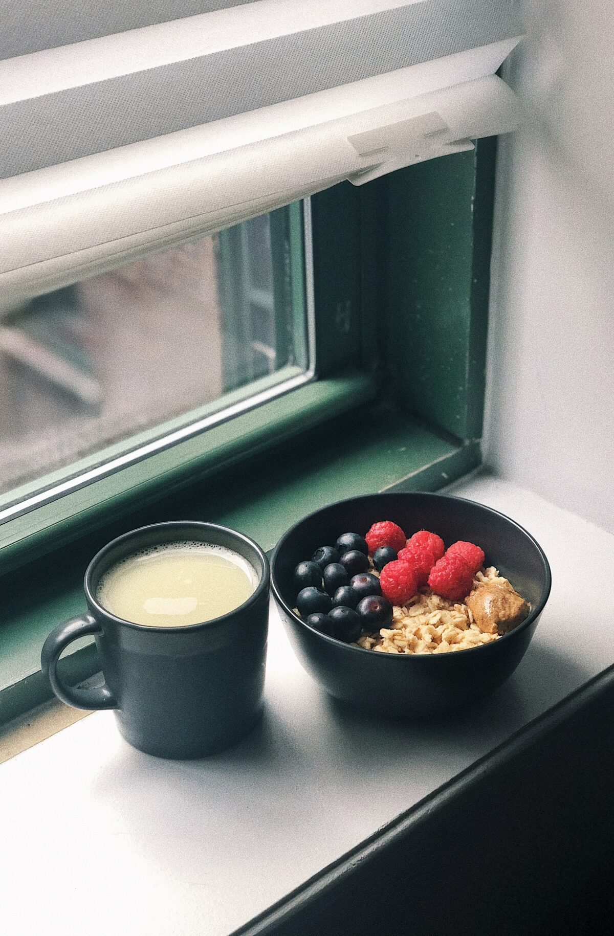 black ceramic mug with white liquid inside