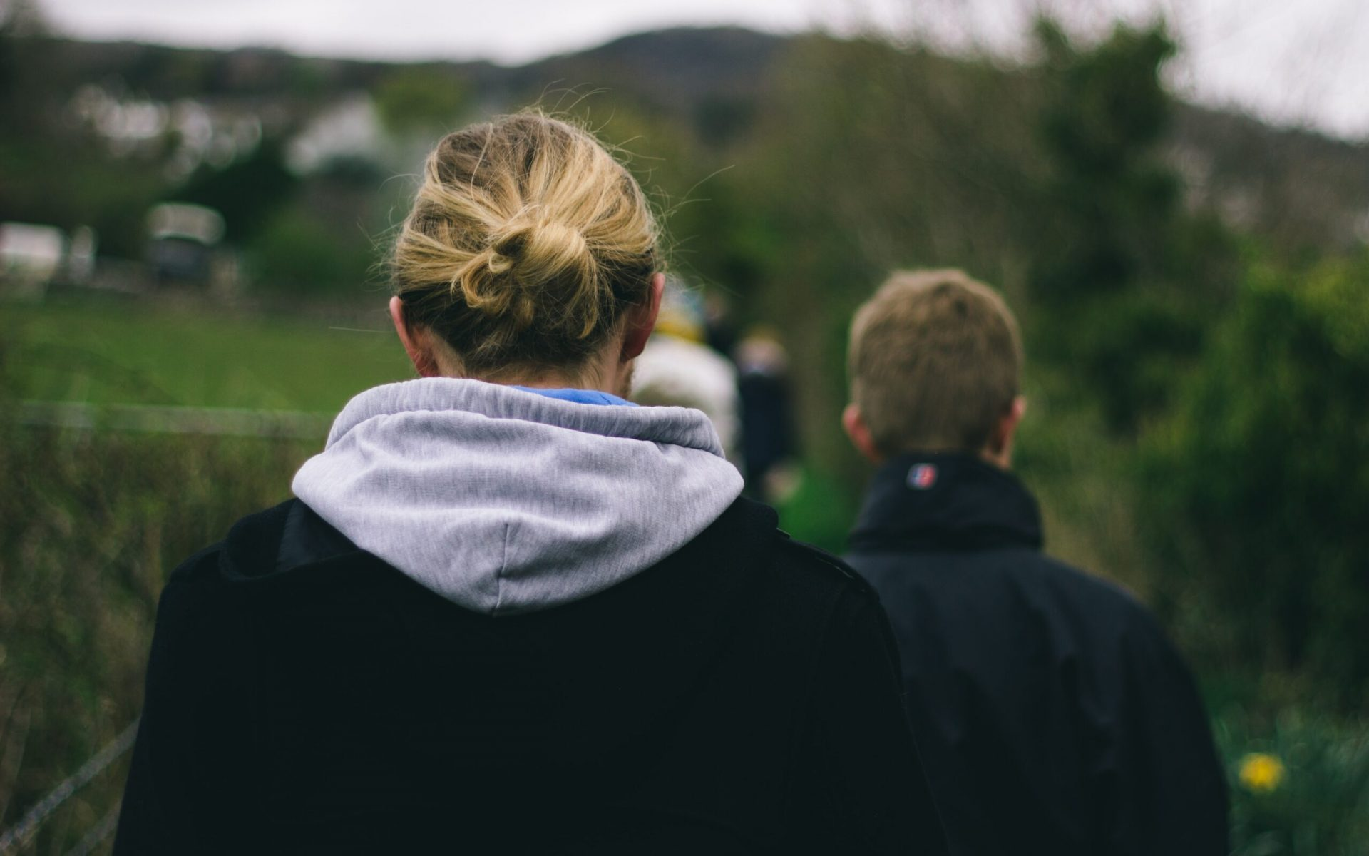 photo of two person walking during daytime